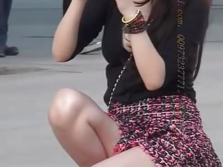 Chinese girl in short skirt