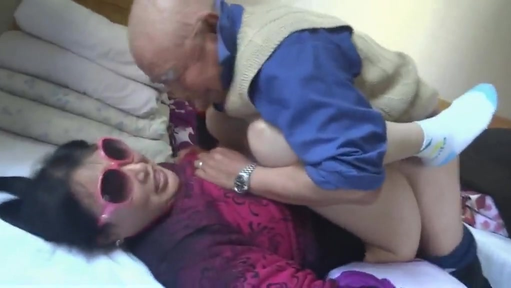 Chinese granny is having fun with grandpa